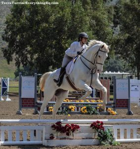 Kayla and Whitey having some fun over jumps.